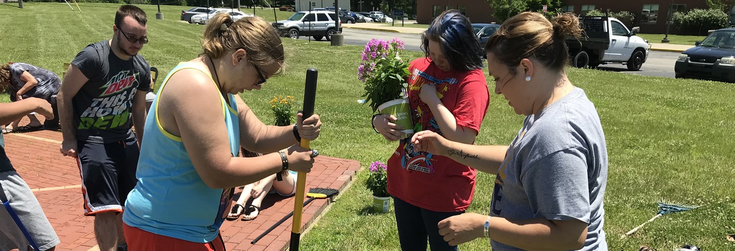 Grant County high school students spruce up the school's outdoor classroom as a part of a Pre-ETS summer camp service project