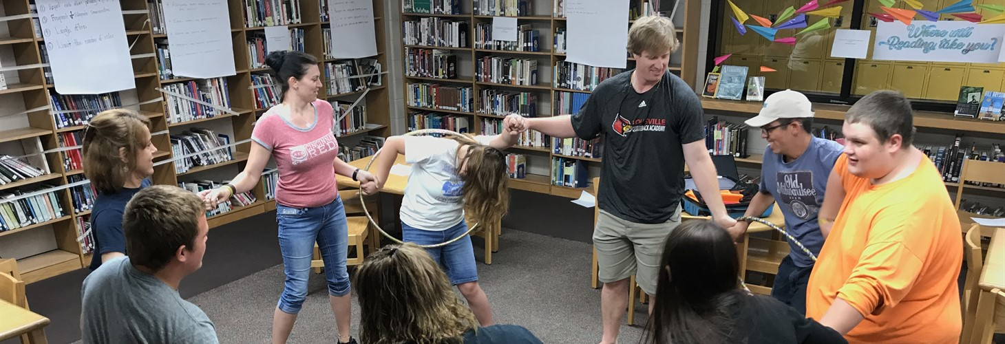 Carroll County high school students and staff participate in a team-building activity as a part of a Pre-ETS summer camp