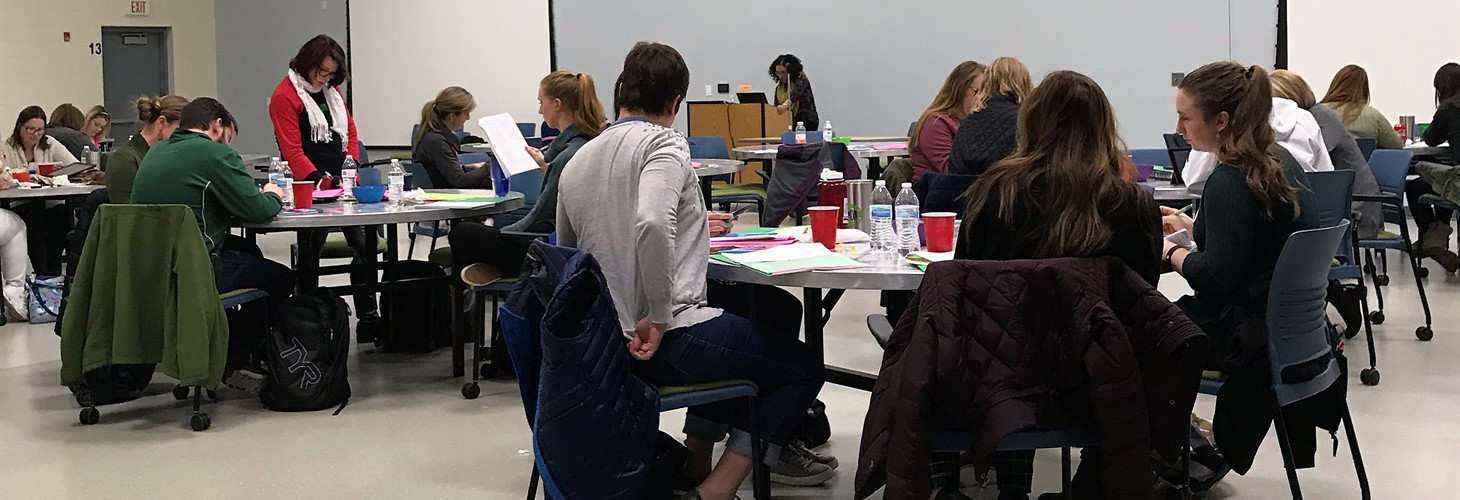 Dr. Noha Minshai-Patterson coding with participants at ADOS-2 training at the Blair Center