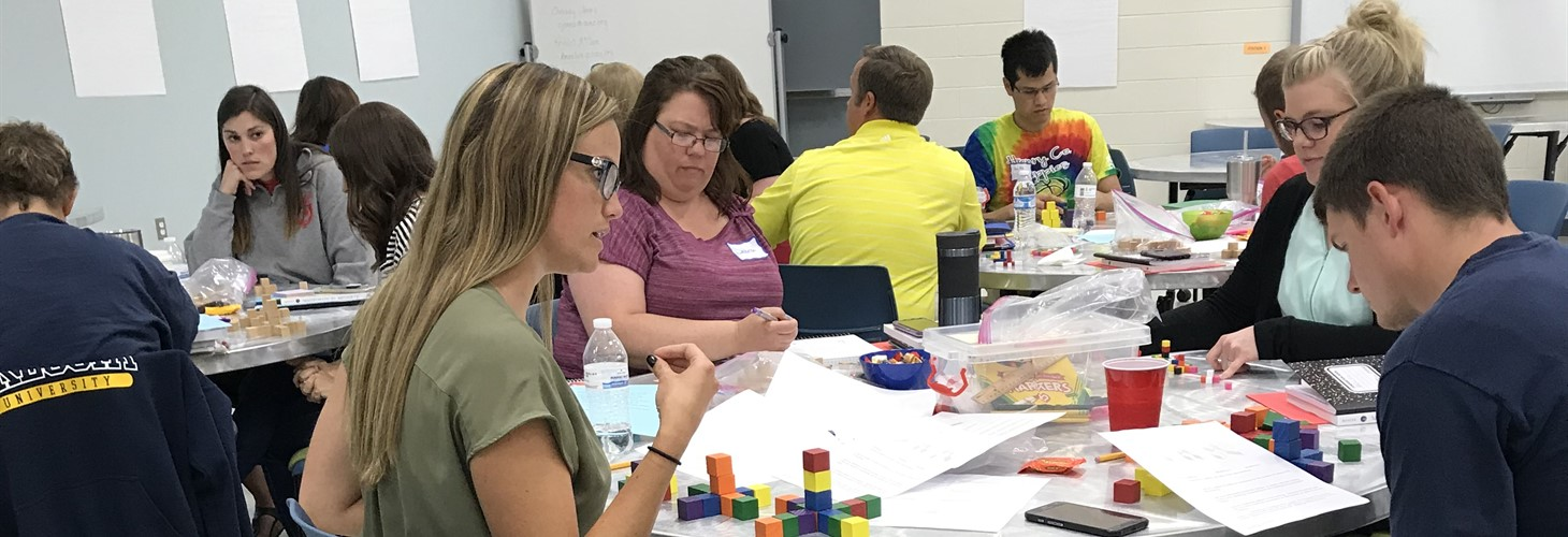 "Middle and High School math teacher leaders ""doing math"""