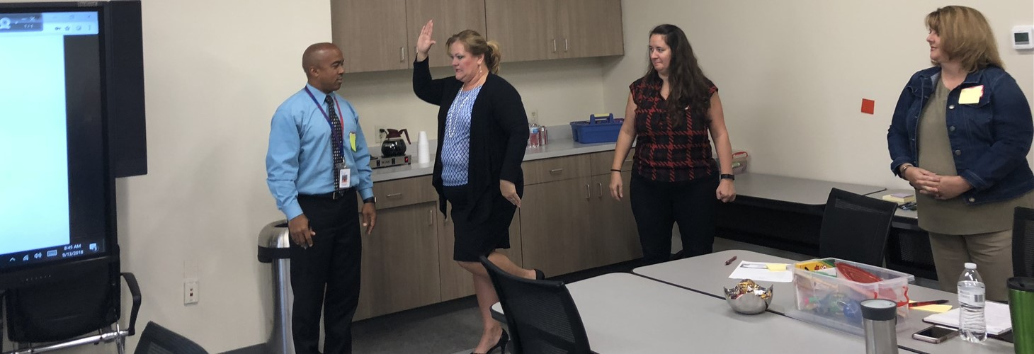 OVOP principals using non-verbal communication as they introduce themselves